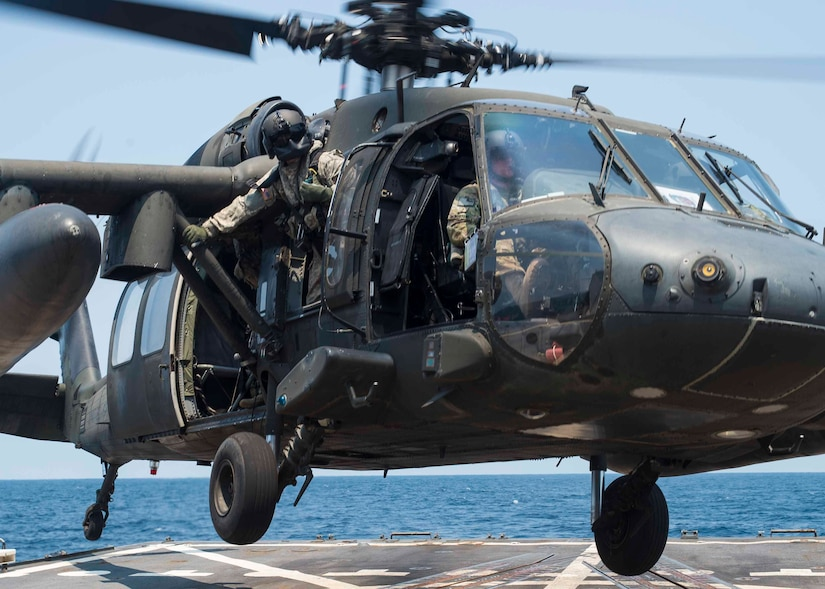 A UH-60 Blackhawk assigned to the 1st Battalion, 228th Aviation Regiment, Joint Task Force Bravo at Soto Cano Air Base, Honduras, launches from the helipad of the USS Lassen during deck landing qualifications off the coast of Honduras, April 14, 2016. The deck landing qualifications familiarizes Blackhawk crews with shipboard operations and enhances their ability to conduct a variety of operations in the U.S. Southern Command's area of responsibility. (U.S. Air Force photo by Staff Sgt. Siuta B. Ika)