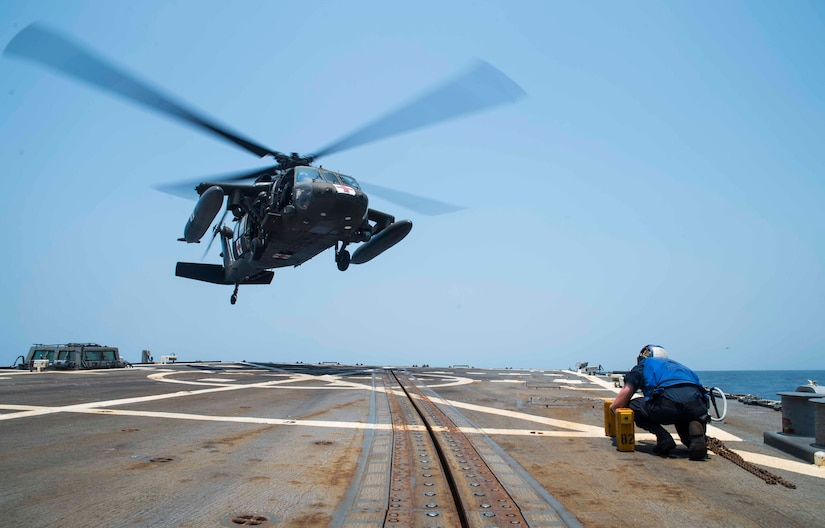 A UH-60 Blackhawk assigned to the 1st Battalion, 228th Aviation Regiment, Joint Task Force Bravo at Soto Cano Air Base, Honduras, prepares to land aboard the USS Lassen during deck landing qualifications off the coast of Honduras, April 14, 2016. Achieving and maintaining deck landing qualifications ensures flight crews are mission ready to support any humanitarian assistance, disaster relief or other contingency operations. (U.S. Air Force photo by Staff Sgt. Siuta B. Ika)