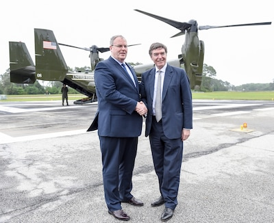 U.S. Deputy Defense Secretary Bob Work and U.K. Defense Procurement Minister Philip Dunne greet at Naval Submarine Base Kings Bay, Ga., en route to Naval Air Station Jacksonville, Fla., April 15, 2016. The defense leaders spent two days visiting military installations in the southeastern United States. DoD photo by Army Sgt. 1st Class Clydell Kinchen