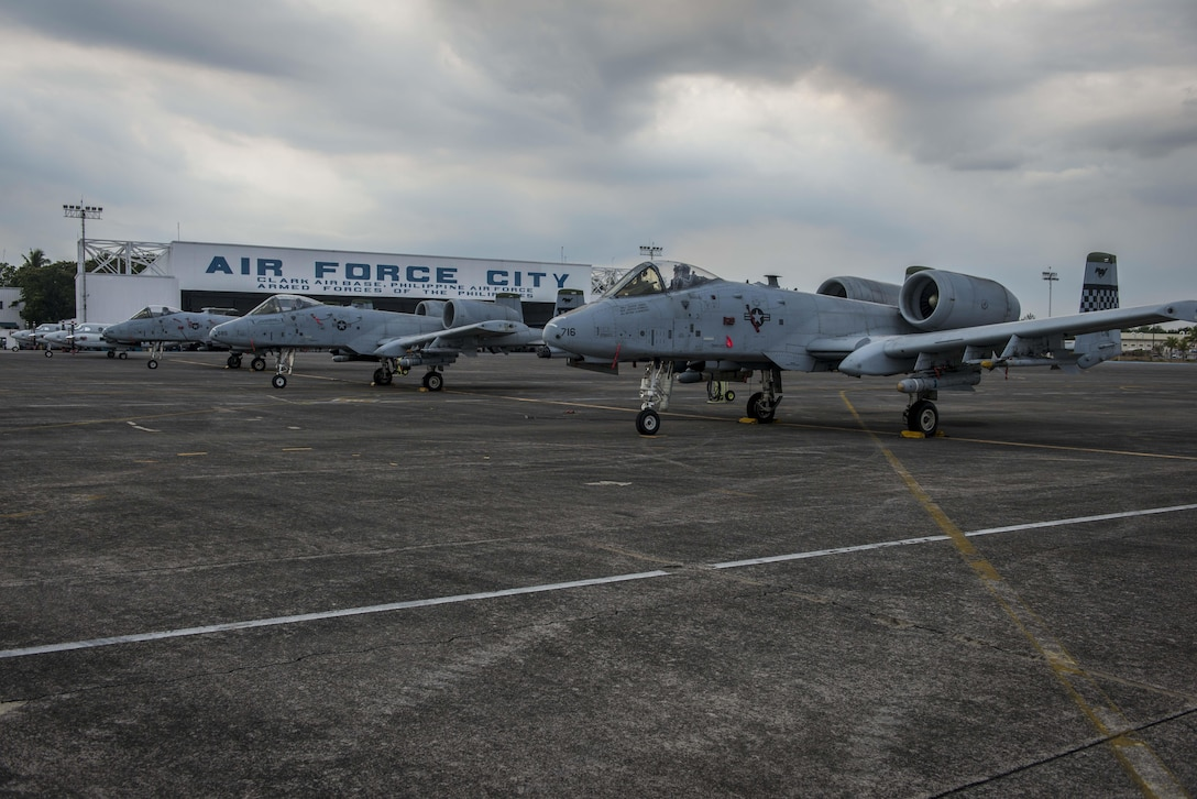 Three of five U.S. Air Force A-10C Thunderbolt IIs, with the 51st Fighter Wing, Osan Air Base, Republic of Korea, sit on the flight line of Clark Air Base, Philippines, April 16, 2016, after having flown missions in support of Exercise Balikatan 16. The A-10Cs are part of a newly stood up Air Contingent in the Indo-Asia-Pacific region that provides credible combat forces to the region capable of a variety of mission including force projection, air and maritime domain awareness, personnel recovery, combating piracy, and assuring access to the air and maritime domains in accordance with international law. The A-10Cs were joined by three HH-60G Pavehawks and approximately 200 Pacific Air Forces personnel including aircrew, maintainers, logistics and support personnel. (U.S. Air Force photo by Staff Sgt. Benjamin W. Stratton)