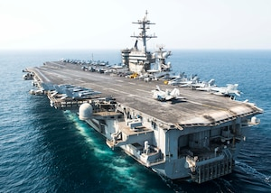 (Oct. 10, 2015) The aircraft carrier USS Theodore Roosevelt (CVN 71) transits the Arabian Gulf. Theodore Roosevelt is deployed in the U.S. 5th Fleet area of operations supporting Operation Inherent Resolve, strike operations in Iraq and Syria as directed, maritime security operations and theater security cooperation efforts in the region.