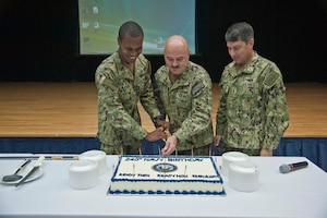 (Oct. 13, 2015) Vice Adm. Kevin Donegan, right, commander of U.S. Naval Force Central Command/U.S. 5th Fleet/Combined Maritime Forces participates in a 240th Navy birthday cake-cutting with Intelligence Specialist 3rd Class Elijah Buford, left, the youngest Sailor and Lt. Cmdr. Christopher Haley, the eldest Sailor at Naval Support Activity, Bahrain. U.S. Naval Force Central Command/Commander, U.S. 5th Fleet is responsible for 2.5 million square miles of area including the Arabian Gulf, Sea of Oman, Gulf of Aden, Red Sea and parts of the Indian Ocean and 20 countries.