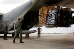 Marines load a pallet of bottled water and hazard protection gear into a KC-130J Super Hercules aircraft at U.S. Marine Corps Air Station Futenma in Japan, March 16, 2011. Following an April 16, 2016, earthquake near Kumamoto, Japan, U.S. forces in the country are preparing to support the Japanese government's relief efforts. Marine Corps photo by Cpl. Dengrier M. Baez