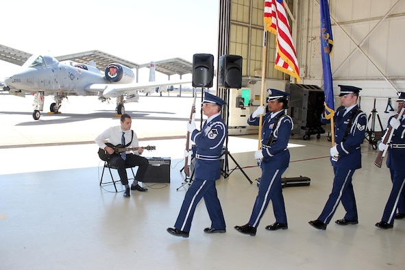 The 127th Wing Honor Guard posts the colors as Dave Spehar, the son of Lt. Col. David Spehar prepares to play the National Anthem during the change of command ceremony for the 127th Maintenance Group at Selfridge Air National Guard Base, Mich., April 16, 2017. Lt. Col. Spehar took command of the Group during the ceremony. (U.S. Air National Guard photos by Tech. Sgt. Dan Heaton)