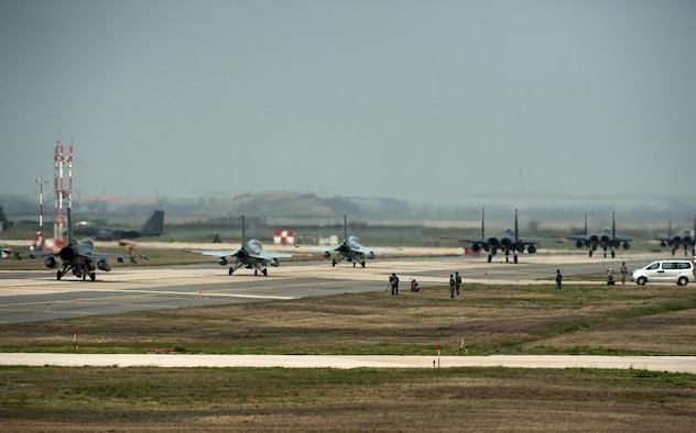 Aircraft from the 8th Fighter Wing, 19th Fighter Wing, Jungwon Air Base, Republic of Korea, and the 11th Fighter Wing, Daegu Air Base, ROK, taxi towards the runway during Max Thunder 16 at Kunsan Air Base, Republic of Korea, April 18, 2016. Exercise Max Thunder is part of a continuous exercise program to enhance interoperability between U.S. and ROK forces. (U.S. Air Force photo by Staff Sgt. Nick Wilson/Released)