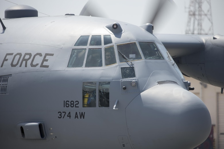 A C-130 Hercules taxis down the flightline at Yokota Air Base, Japan, April 18, 2016. The 374th Airlift Wing sent two aircraft in support of the government of Japan in their relief efforts for the series of earthquakes that took place in the Kyushu region recently. The aircraft transported heavy vehicles and personnel from Chitose Air Base, Hokkaido to Kyushu. (U.S. Air Force photo/Yasuo Osakabe)