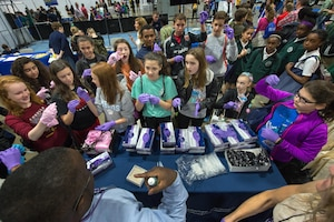 Students conduct a science experiment at a Defense Department exhibit at the USA Science and Engineering Festival in Washington, D.C., April 15, 2016. DoD photo by EJ Hersom