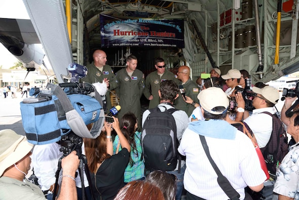 "53rd Weather Reconnaissance Squadron ""Hurricane Hunter"" aircrew members answer questions from local media in Puerto Vallarta, Mexico, about the mission of the Hurricane Hunters during the Caribbean Hurricane Awareness Tour April 12, 2016. The purpose of the CHAT is to raise hurricane awareness across Latin America and the Caribbean, and to maintain and expand partnerships among the National Hurricane Center, U.S. Northern Command, the U.S. Air Force and our neighbors in the region. (U.S. Air Force photo/Tech. Sgt. Ryan Labadens)"