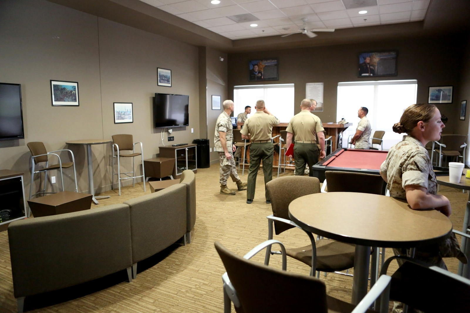 U.S .Marine non-commissioned officers and senior leaders from 7th Engineer Support Battalion explore the new NCO lounge, known as Chapultepec's, in their barracks building aboard Camp Pendleton, Calif., April 15, 2016. The newly opened lounge is dedicated to give the NCOs a place in the barracks to come together and unwind, forming stronger camaraderie in their ranks. (U.S. Marine Corps photo by Cpl. Carson Gramley/released)