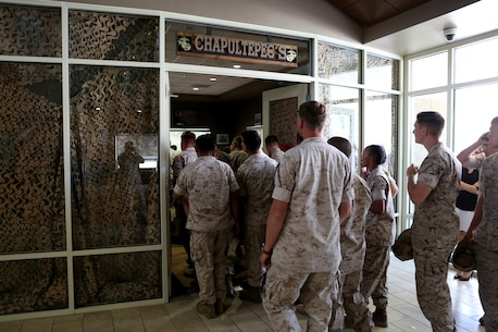 U.S. Marine non-commissioned officers from 7th Engineer Support Battalion enter their new NCO lounge, known as Chapultepec's, in their barracks building aboard Camp Pendleton, Calif., April 15, 2016. The newly opened lounge is dedicated to give the NCOs a place in the barracks to come together and unwind, forming stronger camaraderie in their ranks. (U.S. Marine Corps photo by Cpl. Carson Gramley/released)