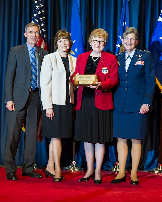 DAYTON, Ohio -- Virginia Miller (red jacket) received the 2015 Director's Award for Volunteer of the Year for her dedication and excellence in serving the National Museum of the U.S. Air Force. (from left to right) Museum Director Lt. Gen. (Ret.) Jack Hudson, Air Force Museum Foundation Chairman Board of Managers Fran Duntz, Museum Volunteer Virginia Miller, and Commander of Air Force Materiel Command, Gen. Ellen M. Pawlikowski. (U.S. Air Force photo)