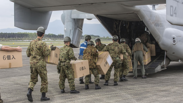 Marines with Marine Medium Tiltrotor Squadron 265 (Reinforced), 31st Marine Expeditionary Unit, assists the Government of Japan in supporting those affected by recent earthquakes in Kumamoto, Japan, April 18, 2016. VMM-265 picked up supplies from Japan Ground Self-Defense Force Camp Takayubaru and delivered them to Hakusui Sports Park in the Kumamoto Prefecture. The long-standing relationship between Japan and the U.S. allows U.S. military forces in Japan to provide rapid, integrated support to the Japan Self-Defense Forces and civil relief efforts. (U.S. Marine Corps photos by Cpl. Nathan Wicks/Released)