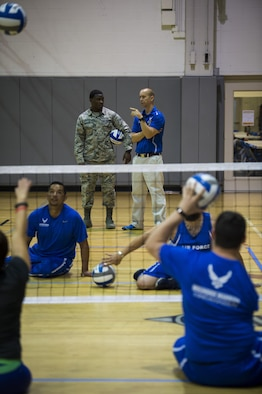 Maj. (Dr.) Sean Martin, right, the chief of sports medicine with Air Force Special Operations Command Office of the Surgeon General, talks to Airman 1st Class Astin Roberson, left, a physical therapy technician with the 1st Special Operations Medical Operations Squadron, at sitting volleyball practice during a Warrior Games training camp at Hurlburt Field, Fla., April 4, 2016. Martin and other medical technicians provide extra services to the athletes during the training camp to ensure as much of their time as possible is spent in the competition and not on the sideline. (U.S. Air Force photo by Staff Sgt. Marleah Miller)