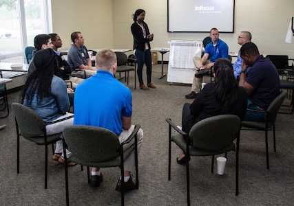 Kimoy Willis (center), an Applied Suicide Intervention Skills Training (ASIST) instructor with the 457th Quartermaster Company leads a small group discussion about the subtle signs of suicide during an ASIST workshop conducted April 15-17, 2016, in Orlando, Fla. More than 25 Army Reserve Soldiers and civilians assigned to the 143rd Sustainment Command (Expeditionary) participated in this three-day workshop to learn how to use scientifically tested tools and methods to provide immediate yet compassionate care to individuals contemplating suicide. (U.S. Army photo by Sgt. John L. Carkeet IV, 143rd Sustainment Command (Expeditionary))