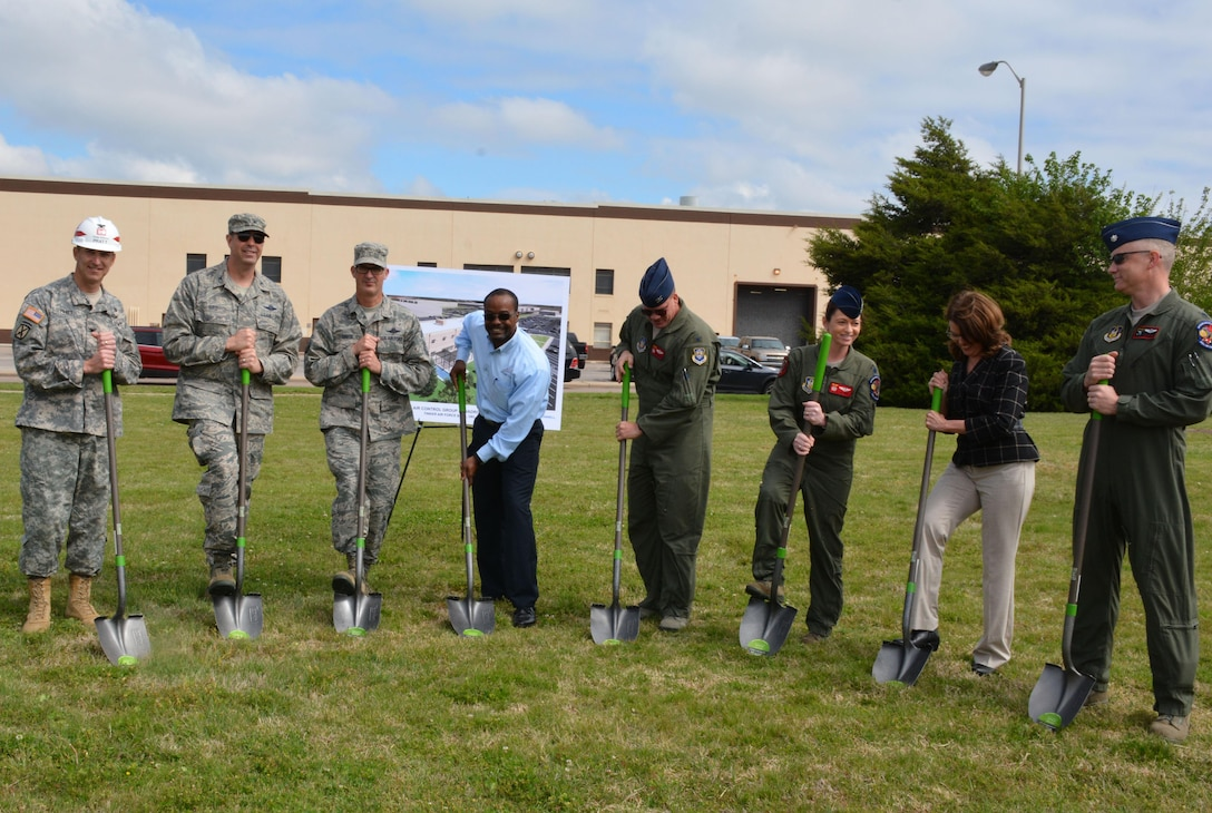 Officials from Tinker Air Force Base, Air Force Reserve, Fortis Networks, Inc. and the U.S. Army Corps of Engineers break ground for the future 513th Air Control Group operations building here during a ceremony April 14, 2016.