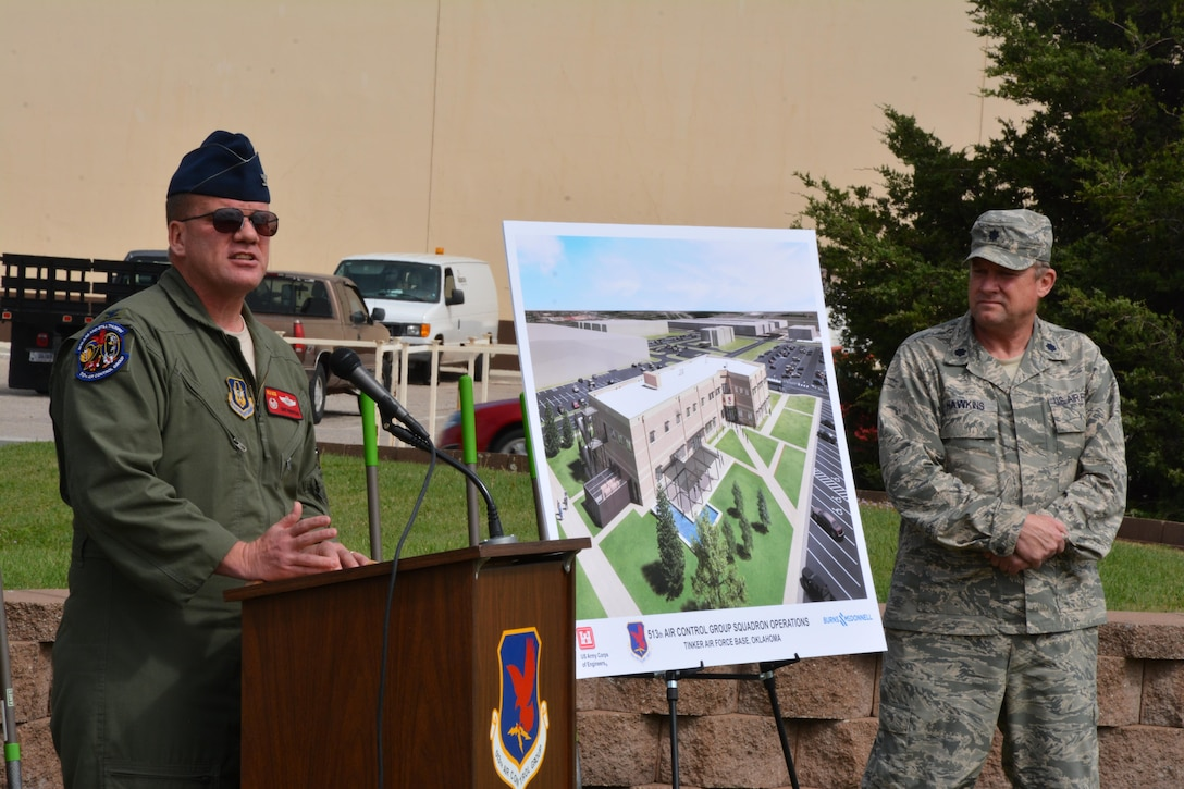 Col. David Robertson, commander of the 513th Air Control Group delivers a speech during the groundbreaking ceremony for the new operations facility April 14, 2016.  The 513th ACG is an associate Reserve unit, which augments the 552nd with crews and maintenance personnel for the E-3 Sentry, Airborne Warning and Control System, also known as AWACS. (U.S. Air Force photo/Maj. Jon Quinlan)