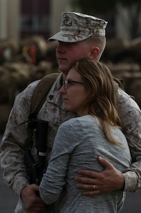 MARINE CORPS BASE CAMP PENDLETON, Calif. – Sgt. Ricki Miles, a counter-battery radar operator with the Special Purpose Marine Air-Ground Task Force - Crisis Response - Central Command 16.2, embraces his wife one last time before departing Camp Pendleton April 14, 2016. SPMAGTF-CR-CC is a rotational contingent of approximately 2,300 Marines and sailors sourced from units throughout I Marine Expeditionary Force. The unit serves as the Marine Corps' land-based, expeditionary crisis and contingency force in U.S. Central Command. (U.S. Marine Corps photo by Cpl. Angel Serna/Released)