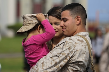MARINE CORPS BASE CAMP PENDLETON, Calif. – Sgt. Francisco Cardenas, an administration noncommissioned officer in charge with the Special Purpose Marine Air-Ground Task Force - Crisis Response - Central Command 16.2, shares a moment with his wife and daughter before departing Camp Pendleton April 14, 2016. SPMAGTF-CR-CC is a rotational contingent of approximately 2,300 Marines and sailors sourced from units throughout I Marine Expeditionary Force. The unit serves as the Marine Corps' land-based, expeditionary crisis and contingency force in U.S. Central Command. (U.S. Marine Corps photo by Cpl. Angel Serna/Released)