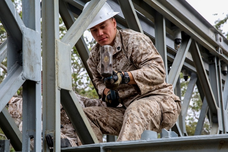 MARINE CORPS BASE CAMP PENDLETON, Calif. - Sgt. Chris Piette helps construct a bridge on Camp Talega at Camp Pendleton April 13, 2016. Piette is a combat engineer with 7th Engineer Support Battalion, I Marine Logistics Group, and is a De Pere, Wisconsin native. Bailey bridge was originally designed during World War II and was one of the most critical engineering components of that time. (U.S. Marine Corps photo by Lance Cpl. Shellie Hall/Released)