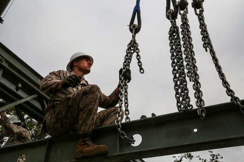 MARINE CORPS BASE CAMP PENDLETON, Calif. - Sgt. Chris Piette secures a transom of a Bailey bridge on Camp Talega at Camp Pendleton April 13, 2016. Piette is a combat engineer with 7th Engineer Support Battalion, I Marine Logistics Group, and is a De Pere, Wisconsin native. The bridge provides mobility during times of flooding and severe rain. (U.S. Marine Corps photo by Lance Cpl. Shellie Hall/Released)