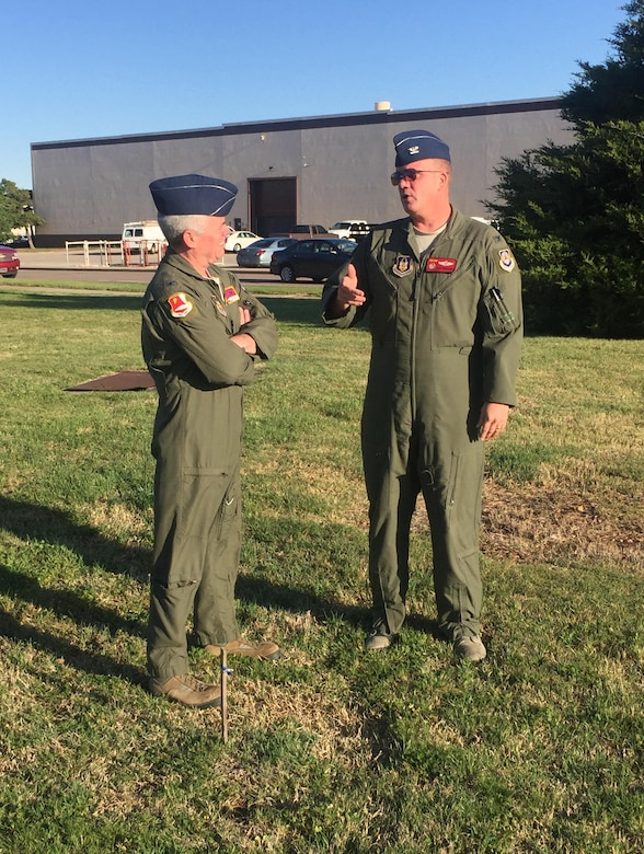 Col. John Trnka, former 513th Air Control Group commander and Col. David Robertson,  513th ACG current commander discuss the new 513th ACG operations facility at the site of the ground breaking.  Col. Trnka initial worked to get the 513th ACG building prioritized ten years ago. (Courtesy photo)