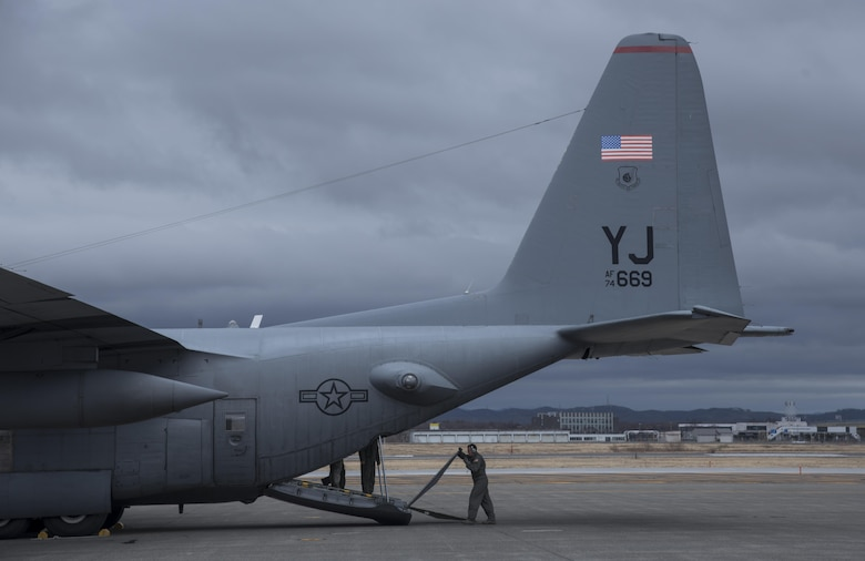 A U.S. Air Force Airman from the 36th Airlift Squadron lowers a ramp on the back of a C-130 Hercules at Chitose, Hokkaido, Japan, April 18, 2016. U.S. forces are assisting the Government of Japan by transporting vehicles and personnel from Hokkaido to Kumamoto Prefecture, the epicenter of a recent earthquake that devastated the area. (U.S. Air Force photo by Staff Sgt. Michael Washburn/Released)