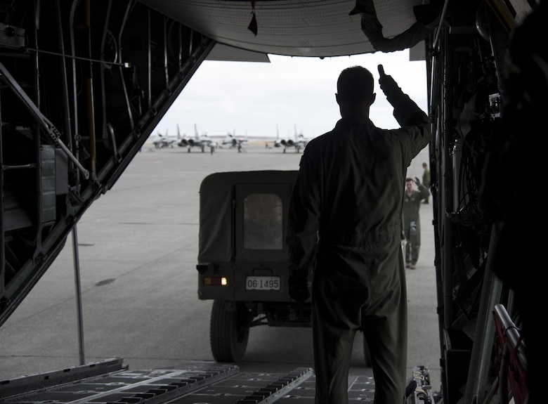 U.S. Air Force Master Sgt. Ryan Atkinson, 36th Airlift Squadron loadmaster, gives a thumbs up to the driver of a Japan Ground Self-Defense Force vehicle as it is loaded on a C-130 Hercules at Chitose, Hokkaido, Japan, April 18, 2016. On April 14 and again on April 16, Japan was struck by devastating earthquakes. The Government of Japan requested the assistance of U.S. Forces Japan, and the 374th Airlift Wing is supporting by transporting vehicles and personnel from Hokkaido to Kumamoto prefecture. (U.S. Air Force photo by Staff Sgt. Michael Washburn/Released)