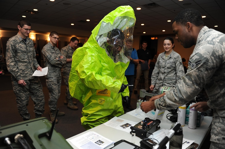 Airman 1st Class Devin Harris, 81st Aerospace Medicine Squadron bioenvironmental technician, helps De'Terris Fox, University of Mississippi Air Force ROTC Cadet, test his finger dexterity while wearing a hazardous material suit at the Keesler Medical Center during Pathways to Blue April 15, 2016, Keesler Air Force Base, Miss. Pathways to Blue, a diversity outreach event hosted by 2nd Air Force, the 81st Training Wing and the 403rd Wing, included more than 180 cadets from Air Force ROTC detachments from various colleges and universities. Cadets received hands-on briefings on technical and flying operations and an orientation flight in support of the Air Force's Diversity Strategic Roadmap program. (U.S. Air Force photo by Kemberly Groue)