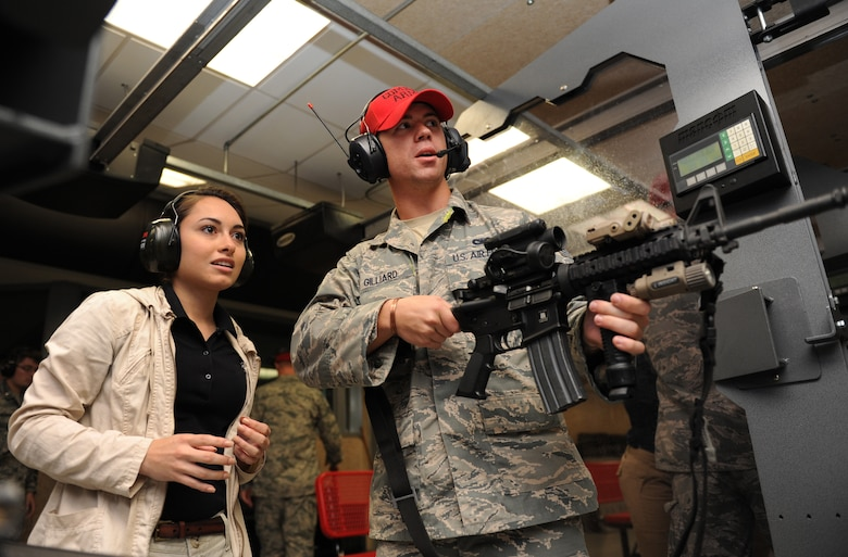 Gabriela Valle-Ramos, University of Alabama Air Force ROTC Cadet, receives M-4 weapon operating instructions from Senior Airman Caleb Gilliard, 81st Security Forces Squadron combat arms instructor, at the 81st SFS combat arms training and maintenance building during Pathways to Blue April 15, 2016, Keesler Air Force Base, Miss. Pathways to Blue, a diversity outreach event hosted by 2nd Air Force, the 81st Training Wing and the 403rd Wing, included more than 180 cadets from Air Force ROTC detachments from various colleges and universities. Cadets received hands-on briefings on technical and flying operations and an orientation flight in support of the Air Force's Diversity Strategic Roadmap program. (U.S. Air Force photo by Kemberly Groue)