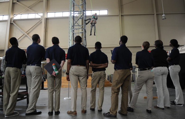 Air Force ROTC cadets watch a tower demonstration by members of the 334th Training Squadron at Matero Hall during Pathways to Blue April 15, 2016, Keesler Air Force Base, Miss. Pathways to Blue, a diversity outreach event hosted by 2nd Air Force, the 81st Training Wing and the 403rd Wing, included more than 180 cadets from Air Force ROTC detachments from various colleges and universities. Cadets received hands-on briefings on technical and flying operations and an orientation flight in support of the Air Force's Diversity Strategic Roadmap program. (U.S. Air Force photo by Kemberly Groue)