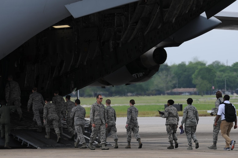 Air Force ROTC cadets board a C-17 Globemaster III for an incentive flight during Pathways to Blue April 15, 2016, Keesler Air Force Base, Miss. Pathways to Blue, a diversity outreach event hosted by 2nd Air Force, the 81st Training Wing and the 403rd Wing, included more than 180 cadets from Air Force ROTC detachments from various colleges and universities. Cadets received hands-on briefings on technical and flying operations and an orientation flight in support of the Air Force's Diversity Strategic Roadmap program. (U.S. Air Force photo by Kemberly Groue)