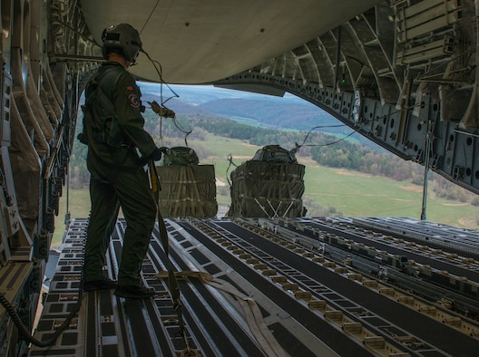 Royal Norwegian air force 2nd Lt. Ulrick Naustuik, Heavy Airlift Squadron loadmaster, participates in Saber Junction 16, April 13, 2016, over Hohenfels, Germany. The exercise involved the 173rd Airborne Brigade and 16 allied and European nations conducting land operations in a joint, combined environment and to promote interoperability with participating nations. (U.S. Air Force photo by Senior Airman Krystal Ardrey/Released)