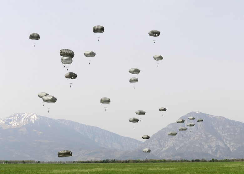 U.S. Army Soldiers and NATO service members participate in a jump exchange prior to Saber Junction 16, April 5, 2016, at Aviano Air Base, Italy. The exercise involved the 173rd Airborne Brigade and 16 allied and European nations conducting land operations in a joint, combined environment and to promote interoperability with participating nations. (U.S. Air Force photo by Airman 1st Class Cory W. Bush/Released)