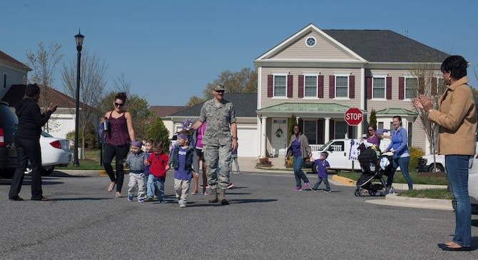 Members Of Joint Base Andrews Family Child Care March In A Purple Parade To Celebrate National