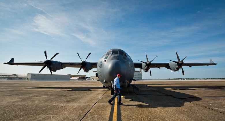 Earl Haun, a Lockheed Martin maintenance contractor with the 413th Flight Test Squadron, walks around a modified MC-130J during preflight checks at Eglin Air Force Base, Fla. The aircraft was fitted with vertical fins on each wing, called winglets.  The 413th Flight Test Squadron aircrew and engineers tested the modified aircraft over eight flights.  The goal of the tests was to collect data on possible fuel efficiency improvements and performance with the winglets and lift distribution control system installed.  (U.S. Air Force photo/Samuel King Jr.)