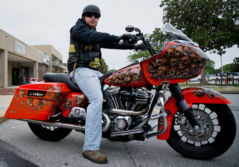 A biker shows off his custom-painted skull bike before taking off from the base's annual motorcycle safety rally April 15 at Eglin Air Force Base, Fla.  Approximately 600 civilian and military riders rode in for the joint 53rd Wing/96th Test Wing event. (U.S. Air Force photo/Samuel King Jr.)