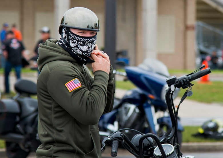 A biker gears up before a ride after the base's annual motorcycle safety rally April 15 at Eglin Air Force Base, Fla.  More than 500 civilian and military riders rode in for the joint 53rd Wing/96th Test Wing event. (U.S. Air Force photo/Samuel King Jr.)