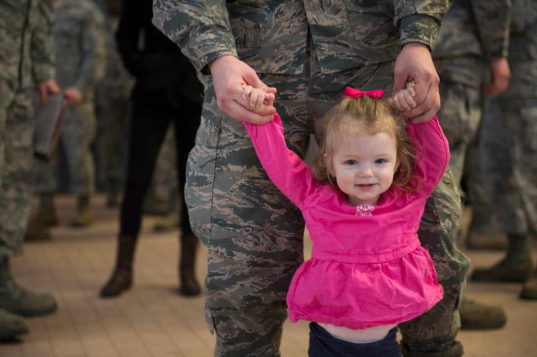 A 606th Air Control Squadron Airman walks around with his daughter before he leaves on a deployment in the 606th ACS compound at Spangdahlem Air Base, Germany, April 5, 2016. The 606th ACS is a self-contained command and control mobile combat unit with Airmen covering more than 21 specialties. (U.S. Air Force photo by Staff Sgt. Christopher Ruano/Released)