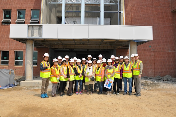 Far East District employees pose for a picture outside the new district headquarters building April 12 at Camp Humphreys. The group were part of an orientation tour designed to give current employees a better understanding of what to expect when the district moves its headquarters to Camp Humphreys next year.