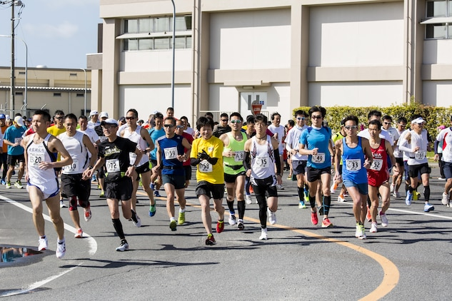 Station residents and Japanese participants begin a half marathon during the 49th Kintai Marathon on Marine Corps Air Station Iwakuni, Japan, April 17, 2016.With more than 500 athletes, the marathon is one of the few events that invites Japanese citizens on the air station and provides a great opportunity for MCAS Iwakuni personnel to show support of their host nation through running, said Mai Tajima, SemperFit recreation specialist. The half marathon first place for the men was Nobuhisa Tanigawa, 35, completing at 1 hour, 13 minutes, 37 seconds, and for the women was Yukiko Kobayakawa, 43, completing at 1:32:26.  (U.S. Marine Corps photo by Cpl. Nathan D. Wicks/Released)