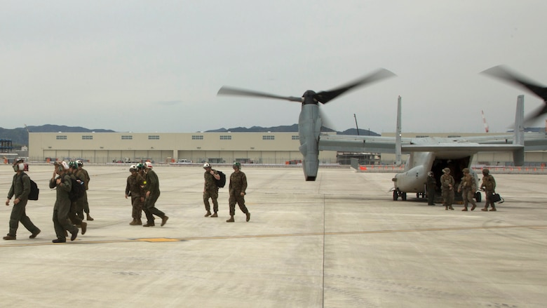 Marines with the 31st Marine Expeditionary Unit disembark MV-22B Ospreys with Marine Medium Tiltrotor Squadron 265 (Reinforced), 31st MEU at Marine Corps Air Station Iwakuni, Japan to support the Japan Ground Self Defense Force with relief efforts after a series of earthquakes struck the island of Kyushu April 18, 2016. The Government of Japan requested assistance for the JGSDF in the relief effort.