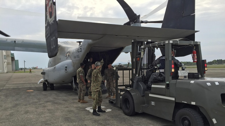 Japan Self Defense Forces service members load an MV-22B Osprey belonging to Marine Medium Tiltrotor Squadron 265 (Reinforced), 31st Marine Expeditionary Unit April 18, 2016 at Marine Corps Air Station, Iwakuni, Japan. 31st MEU Marines are in Iwakuni to support the government of Japan's relief efforts in response to the earthquakes that struck the island of Kyushu earlier this week. The 31st MEU is the only continually forward-deployed MEU and remains the Marine Corps' force-in-readiness in the Asia-Pacific region.