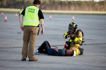 An exercise controller oversees and evaluates a first responder's tending to a simulated casualty during a Mass Casualty Exercise on Marine Corps Air Station Cherry Point, N.C., April 7, 2016.  The exercise was designed to simulate the response if an emergency were to occur. Annually, the air station is required to have exercises to ensure protocol and safety standards are met for potential emergencies. On years the biannual air show occurs, the training revolves around scenarios specific to that kind of event. (U.S. Marine Corps photo by Cpl. Jason Jimenez/Released)