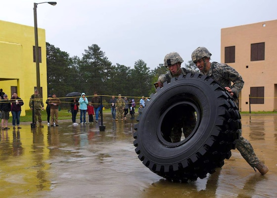 Army Staff Sgt. Erich Friedlein, left, with the Pennsylvania Army National Guard, and his teammate, Army Capt. Robert Killian, with the Colorado Army National Guard, work together to move a large truck tire while competing in the 2016 Lt. Gen. David E. Grange Jr. Best Ranger Competition at Fort Benning, Georgia. The two took first place in the grueling three-day competition that tests competitors on a variety of tactical and technical tasks in a physically and mentally demanding environment, marking the first time an Army Guard team has won in the competition's 33-year history.