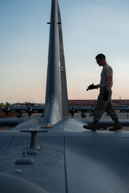 Senior Airman Blaine Miller goes through post-flight inspections of a C-130 at Aviano AB, Italy, in support of Exercise Saber Junction. (U.S. Air Force photo by Staff Sgt. Trevor Saylor)