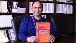 "Dr. Manoj K. Shukla, research physical scientist for the Engineer Research and Development Center displays the book he and and Dr. Jerzy Leszczynski, professor and presidential distinguished fellow, Jackson State University edited that was released in April 2016. Fourth in a series of books on computational chemistry, ""Practical Aspects of Computational Chemistry III"", was published by Springer."