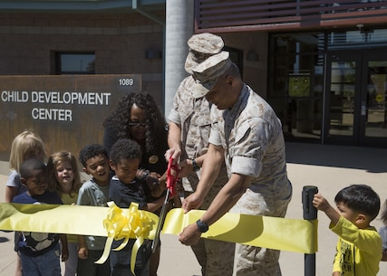 Col. Jay Wylie, assistant chief of staff, G-4 Installations and Logistics and Lt. Col. Frank Marilao, assistant chief of staff, Marine Corps Community Services, conduct the ribbon-cutting ceremony for the Child Development Center aboard the Combat Center April 13, 2016. The development center, also known as 'Stepping Stones', is a 37,000-square-foot facility. (Official Marine Corps photo by Cpl. Connor Hancock/Released)