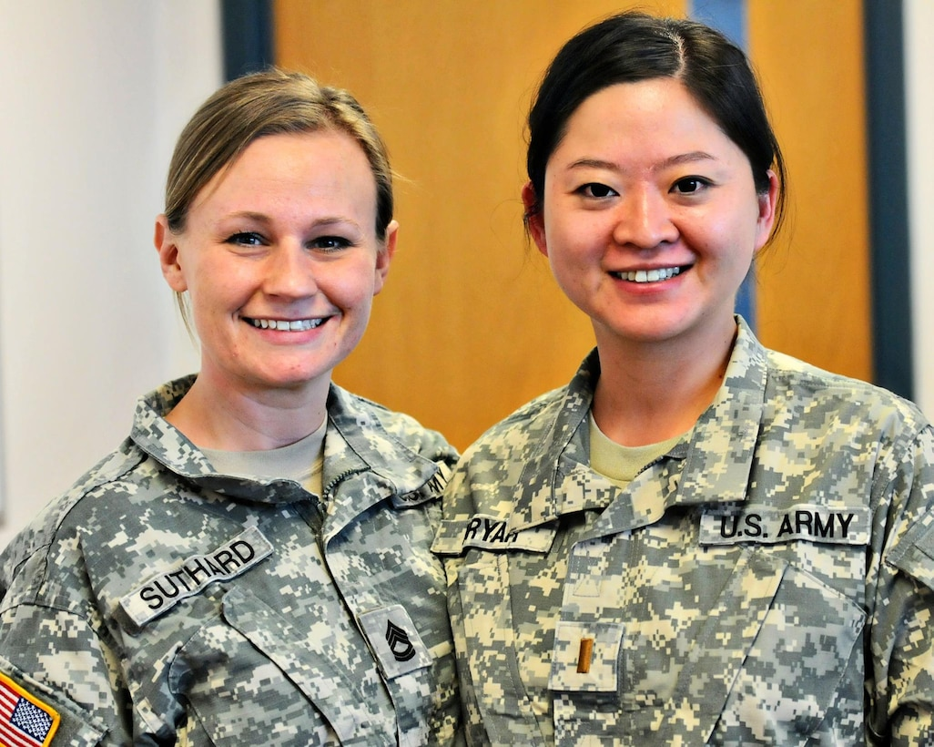 Sgt. 1st Class Nicole Suthard, Internal Review Sergeant, left, and 2nd Lt. Jiaru Bryar, Internal Review Evaluator, right, pause for a photo during the command's April battle assembly. The battle assembly was Bryar's first since her return graduating from Basic Officer Leaders Course (BOLC). (Photo by Spc. David Lietz)