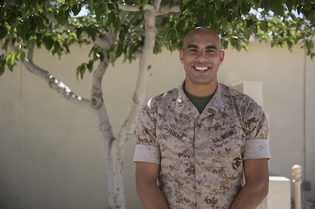 Capt. Joseph Teirab, deputy staff judge advocate, SJA, believes it's important to give back to the community. He ushers at his church on Sunday's and teaches a political science course every Tuesday night. (Official Marine Corps photo by Cpl. Julio McGraw/Released)