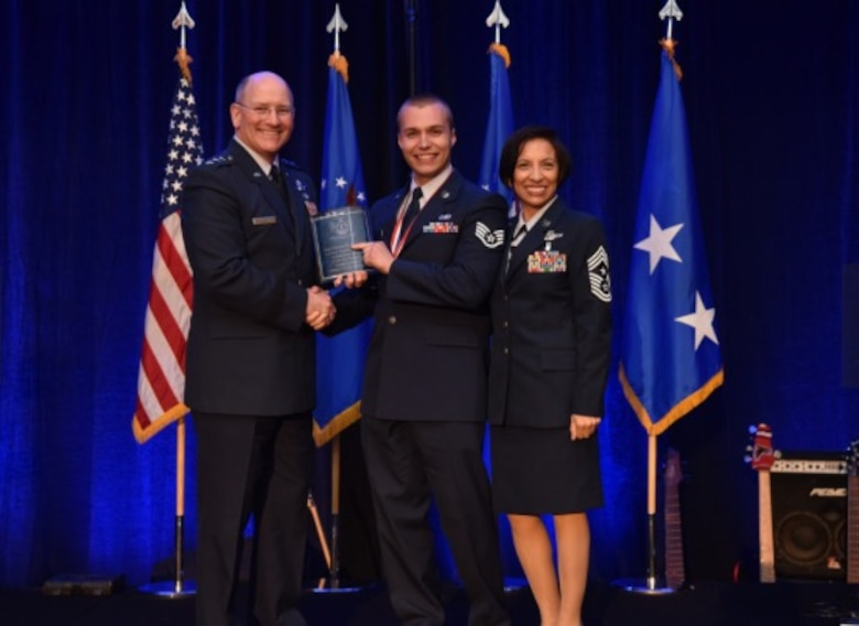 Staff Sgt. Mitchell Ciccarelli, Air Reserve Personnel Center casualty service technician, is presented the 2015 Headquarters Air Force Reserve Command Airman of the Year award by Lt. Gen. James F. Jackson, chief of the Air Force Reserve and commander of AFRC, as Chief Master Sgt. Ericka Kelley, AFRC command chief master sergeant, stands by April 16, 2016, at the AFRC Outstanding Airmen of the Year Banquet held in Jacksonville, Fla. (Air Force courtesy photo)
